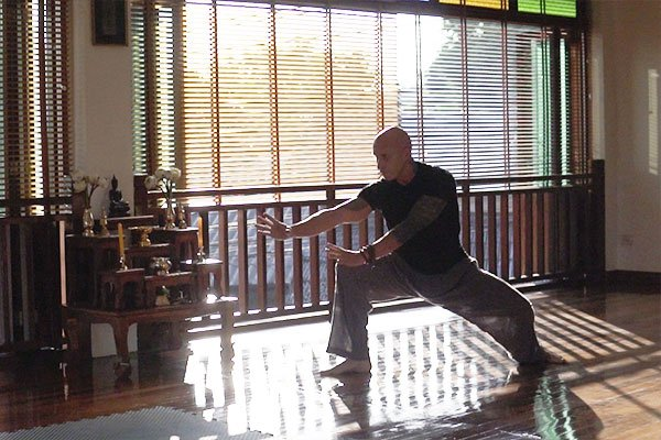 Bald man does traditional Qi-Gong