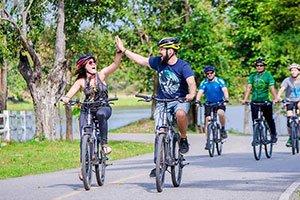 high five on bikes