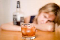alcoholic woman drinking spirits